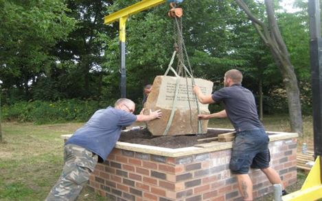 Mounting the monument stone.