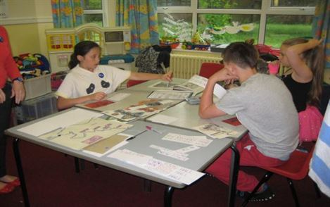 St Augustine's primary school pupils, designing the mural.