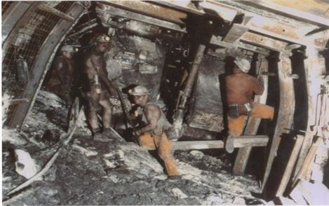 Miners in the pits working.
