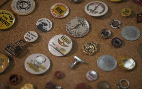 Selection of miners bages and pins used in support of the miners strikes and N.U.M.